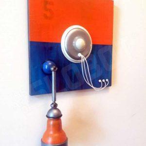 Mike Slobot Robot Painting Number 5 in Orange, Blue, and Violet from Left