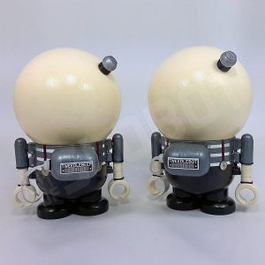 This is a diptych work of art depicting Tweedledee and Tweedledum of Alice in Wonderland as robots. This is the view from the back.