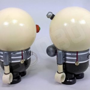 This is a diptych work of art depicting Tweedledee and Tweedledum of Alice in Wonderland as robots. This is the view from the side